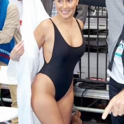 Adrienne Bailon wears a swimsuit in NYC