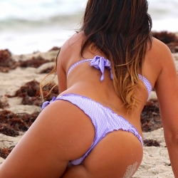 Claudia Romani in purple thong bikini