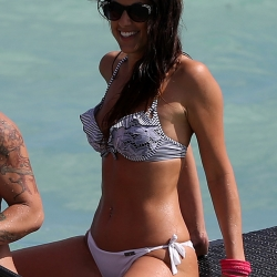 Claudia Romani paddleboarding with Friend