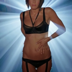 Jennifer Aniston in a see-through bra on set