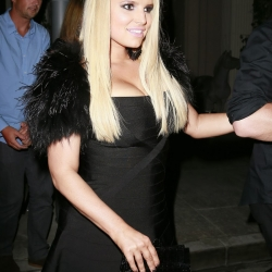 Jessica Simpson cleavy in a black dress