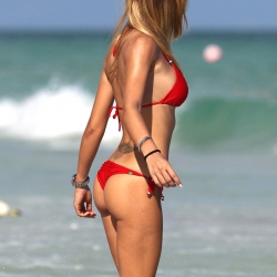 Laura Cremaschi in red tiny bikini