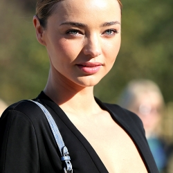 MIranda Kerr Wears A Deep Plunge Dress