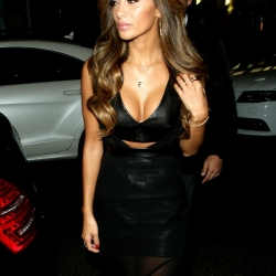 Nicole Scherzinger nipple pokes in a cleavy leather dress