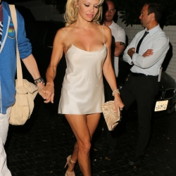 Pamela Anderson Flashes Her Boobs